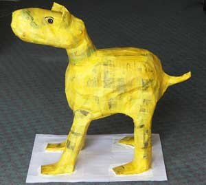 Yellow dog made from newspaper