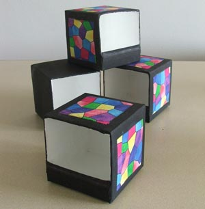 Tidy boxes painted and decorated with bright fabric squares